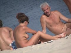 Beach voyeur man enjoys the view of topless female tits