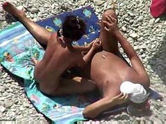 Giving him a handjob at the beach