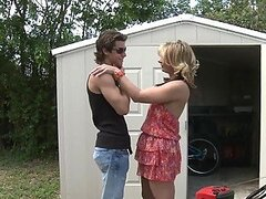 Blonde MILF is fucking with a young gardener at the backyard