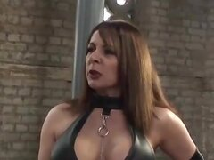 Hot mistress in latex spanks maid and drops hot wax on his big cock
