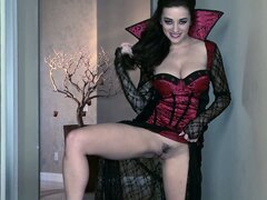 Busty vampire babe goes reaching for her hairy goblet...