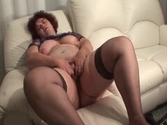 Chubby mature in stockings teasing cunt with dildo