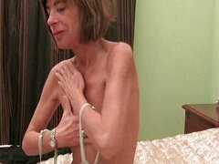 Skinny granny strips off and masturbates