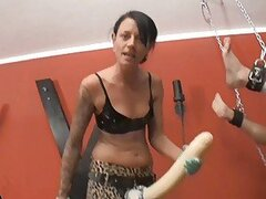 A bitch of a brunette babe ties her man up and drills his ass with a dildo