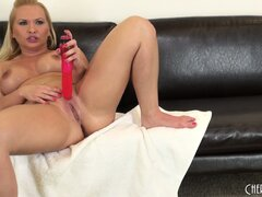 Blonde with thick curves shoves a dildo into her tight pussy