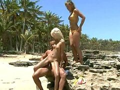 Two Tanned Sluts Get Fucked On The Beach.