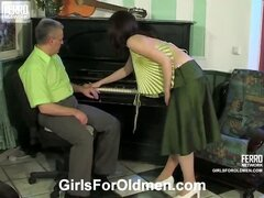 Busty girl in a provoking blouse getting it on with her grey-haired teacher