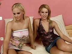 Two sexy blonde lezzies stripping and making out on bed