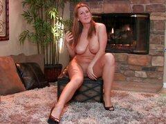 Curvy girl with big tits sits solo...