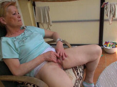 Granny is sitting and masturbating in a solo clip