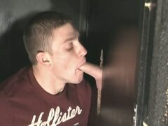 Horny muscled gay hunk opens cum hungry mouth in arcade glory hole