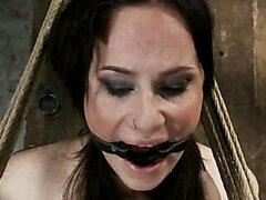 Cute milf is crotch rope suspended, caned, severely flogged and made to cum
