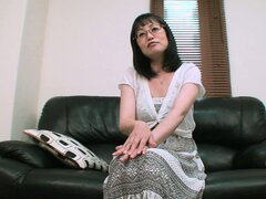 Serious Japanese babe Kazuyo doesn't mind stripping for the camera
