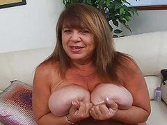 Mature momma with extra massive bosom sticks dildo up her hairy vag