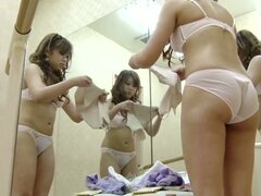 Dressing room girl puts on tricot and fishnet pantyhose