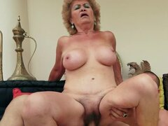 Lewd granny Effie gets her hairy pussy fucked and filled with cum