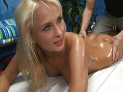 Hot blonde babe covered with oil getting