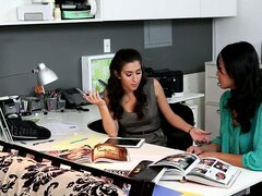 It's a secretarial seduction scene in the office with two hot brunette babes