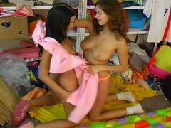 Hot lesbian friends play in the girls room.