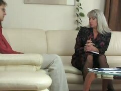 Elegant mature business-lady looking for stress-relief in the guys pants