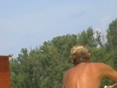 Gorgeous young nudist beach voyeur vid