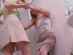 Two lovely blonde housewives going at it in a hot bathroom lesbian scene.