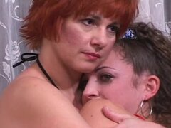 Redhead is spanking her slutty girlfriend