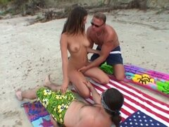 Beach bitch Simony Diamond sucks two cocks one by one