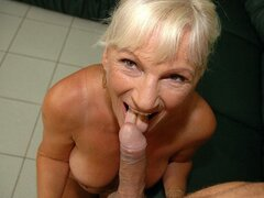 A cum loving granny is on her knees and devouring her man's dagger for the spunk