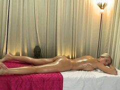 Blonde massage erotically rubbing client