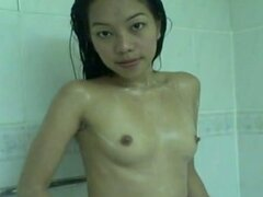 Sexy asian girl gets wet in the bathtub