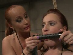 Horny brunette slave endures mistress punishments
