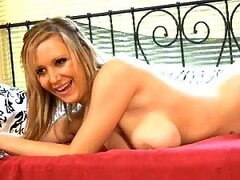 Lucy Alexandra masturbates sitting on the bed