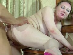 Mature milf in stockings fucks young dude
