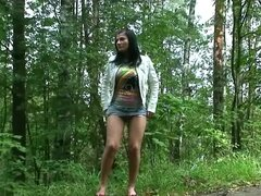 Skirt teen takes a piss outdoors