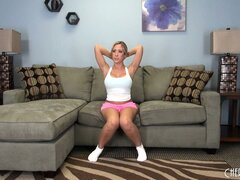 Blonde Capri Cavanni poses on the couch and then does a striptease