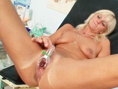 Blonde milf takes pussy enema from doctor