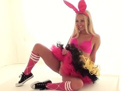 Bunny Ballerina is in a photo shoot and having fun posing and playing