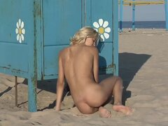 Skinny teen nude in the sand