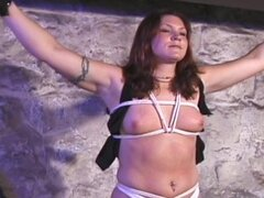 Gagged girl body bent in bondage