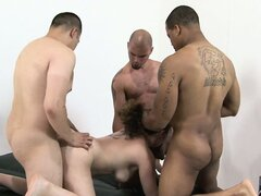 Kiki Daire fucked in her hairy pussy by three horny dudes in a gang-bang fuck video