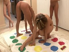 Five college girls playing naked twister party