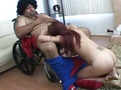 Hot redhead babe doing blowjob to a chubby guy in wheelchair