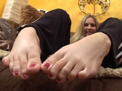 Lynn does footjob and licks cum on her feet