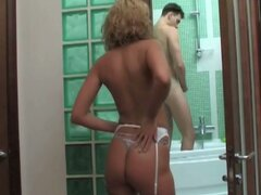 Blonde milf fucks young guy in bathroom