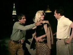 An old retro scene as a beautiful blonde cougar enjoys two tools at once