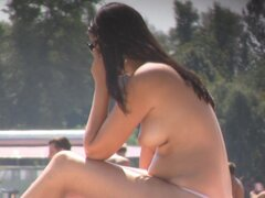 Girl with big belly sunbathing topless on beach voyeur cam