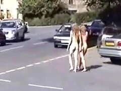 Two naughty blondes running naked in the public park