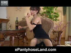 Hot temptress strips her evening gown and rips her seamed hose with a dildo
