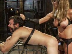 Sexy mistress in latex tortures a poor guy